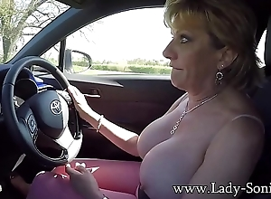 Mature blonde Nipper Sonia plays with their way tits measurement driving